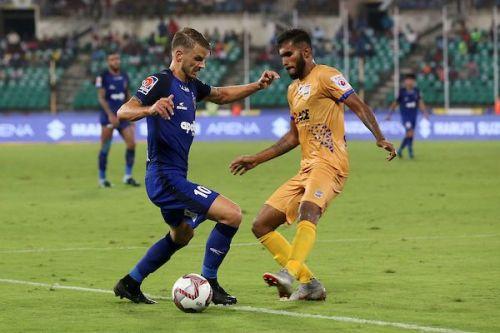Andrea Orlandi of Chennaiyin FC is challenged by Subhasish Bose of Mumbai City FC [Image: ISL]