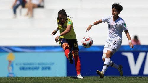 Colombia's Sara Martínez in action against Korea's Kim Ye-Eun in white (Image courtesy: FIFA)