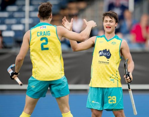 Australian players Tom Craig and Timothy Brand celebrate after the latter scores a goal in a warm-up match against Germany