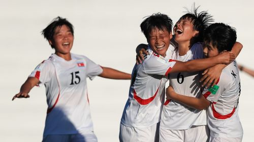 Ri Su-Jong no 6 from Korea DPR celebrates with her teammates after scoring the crucial second goal (Image Courtesy: FIFA)
