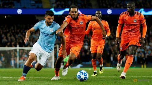 Aguero fights for the ball against Lyon centre-back Jason Denayer