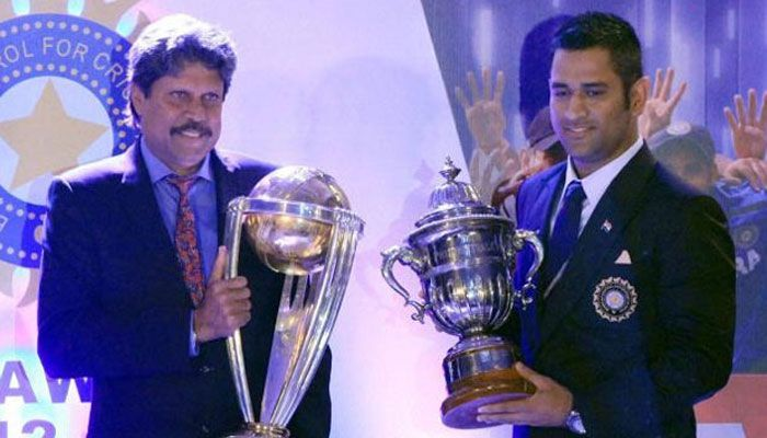 Kapildev and Dhoni with World Cup Trophies