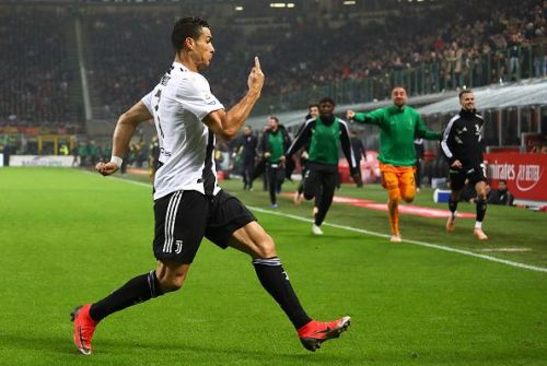 AC Milan v Juventus - Serie A. Ronaldo celebrates the second goal of the game and his 9th.