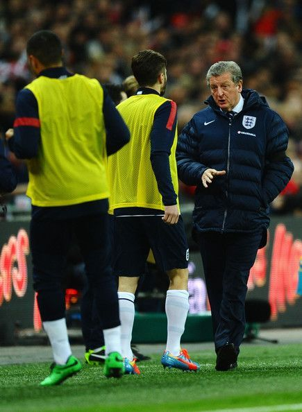 Roy Hodgson giving instructions to Lallana while on England duty