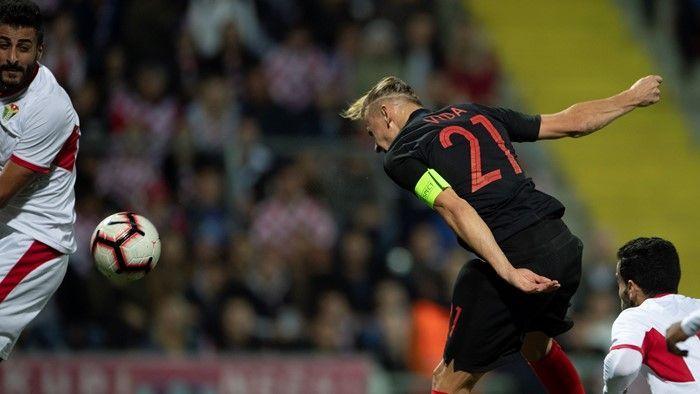 Domagoj Vida nods Croatia ahead against Jordan.