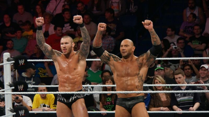 Orton and Batista stand side-by-side as part of Evolution