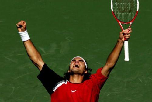 Federer celebrates after defeating Nadal