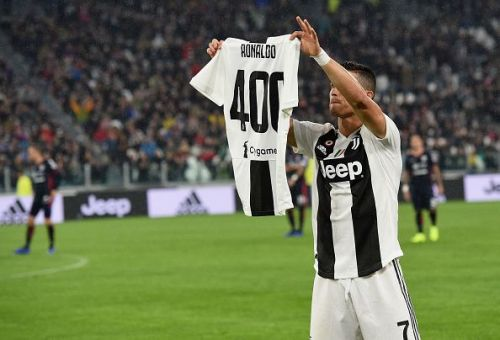 Ronaldo with his celebratory shirt after becoming the first player to score 400 goals in Europe's top five leagues
