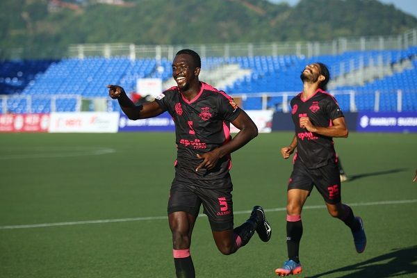 Lancine Toure of Minerva Punjab wheels away after scoring against Aizawl FC during their I-League match