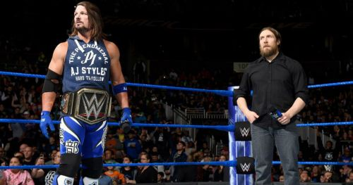 AJ Styles as WWE Champion, while Bryan looks on