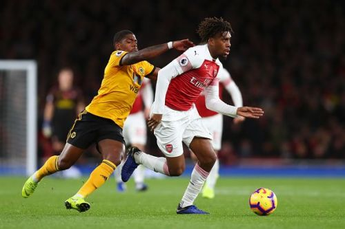 Alex Iwobi in action against Wolverhampton Wanderers in the Premier League