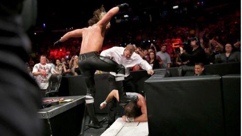 Rollins ramming Ambrose's head to the Cinderblocks!