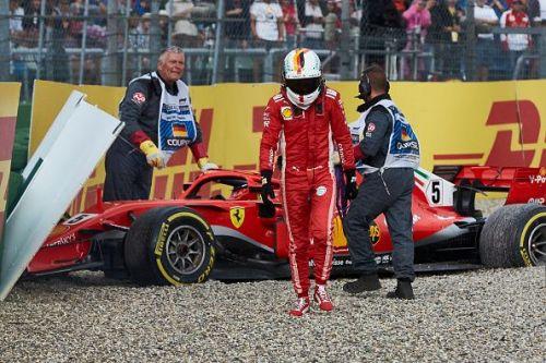Sebastian Vettel walking away after crashing his car in Germany