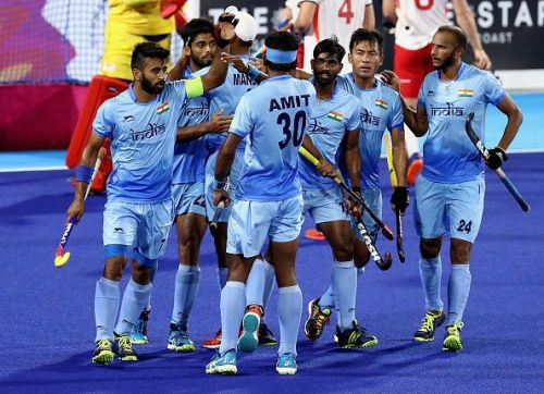 Indian hockey team geared up for the men's World Cup with a 5-0 thrashing of reigning Olympic champions Argentina in its first warm-up match