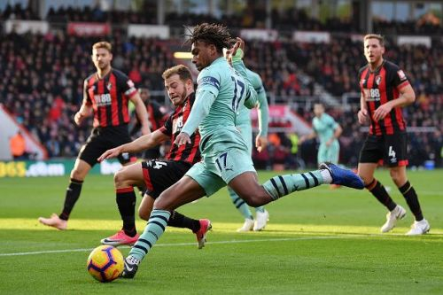 Alex Iwobi tries to fizzle in a low cross against Bournemouth