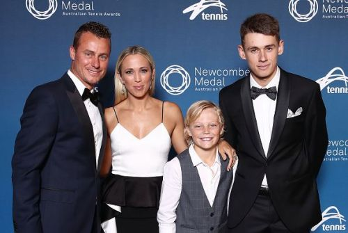 Lleyton Hewitt poses with his family after winning the Newcombe Medal