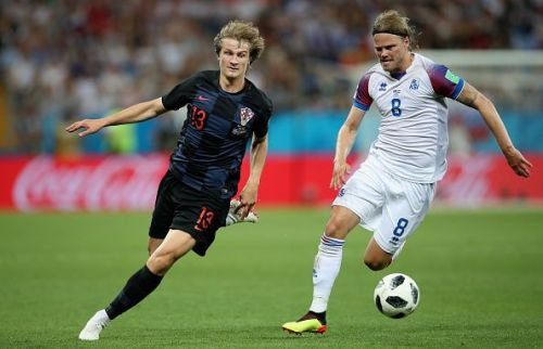 Tin Jedvaj's (left) late brace gave Croatia a vital win over Spain.