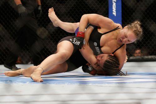 Ronda Rousey takes Alexis Davis down at UFC 175