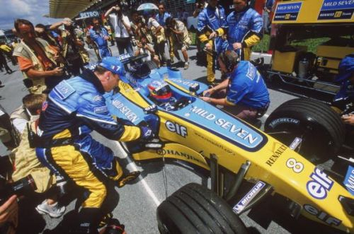 Fernando Alonso of Spain and the Renault team in the pits after claiming pole position