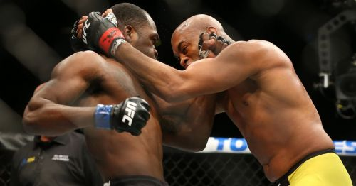 Anderson Silva (right) working the clinch with Derek Brunson (left) during their fight at UFC 208