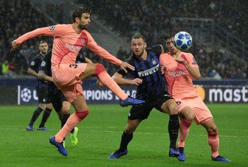 Gerard Pique clears the ball