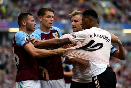 Rashford in a tussle with Burnley's Phil Bardsley - which led to a sending off