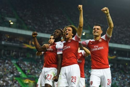 Danny Welbeck and co celebrate a late winner in Lisbon