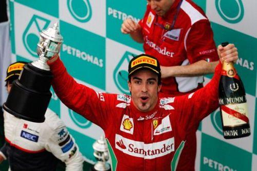 Alonso celebrates his win at the 2012 Malaysian F1 Grand Prix