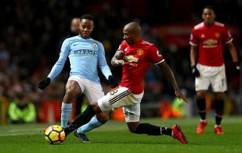 Sterling and Young battling it out last season at Old Trafford