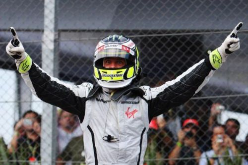 The Brit won the title in Brazil much to the delight of the British fans and of course his father the late John Button
