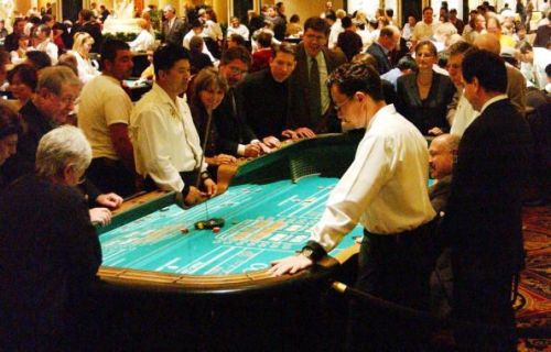 a view of a glamorous crap table in the casino