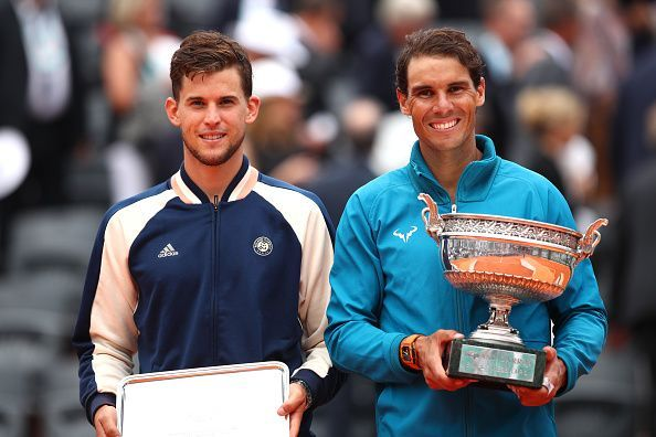Rafael Nadal posing with his 11th French Open Trophy