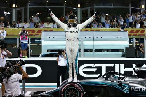 New five-time champion Lewis Hamilton smashed the lap record as he secured pole position at the Abu Dhabi Grand Prix