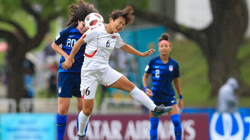 Sophia Jones of the USA no 20 and no 6 Ri Su-Jong of North Korea in action (Image Courtesy: FIFA)