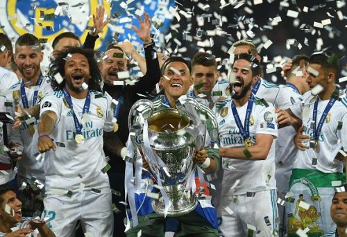 Real Madrid celebrate their 13th Champions League title after winning against Liverpool in the Final