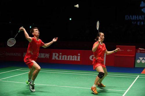 Zheng Siwei (left) and his partner Huang Yaqiong