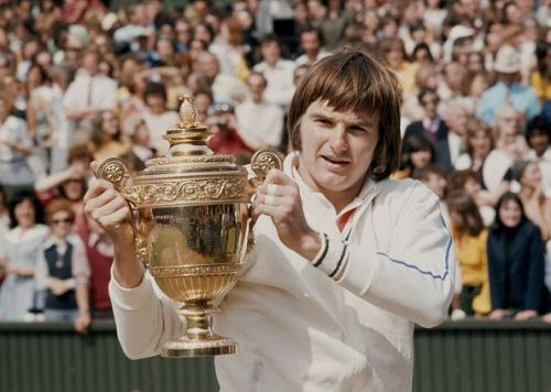 Jimmy Connors with the Wimbledon Lawn Tennis Championship trophy