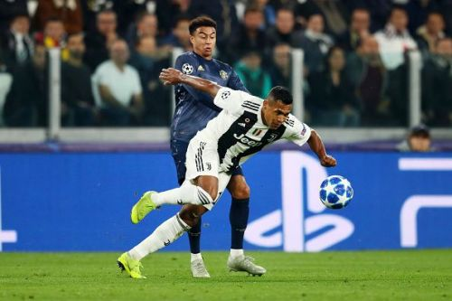 Lingard tussling with Juventus' fullback Alex Sandro in a battle for possession - which he regularly lost