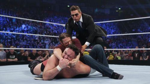 Miz pulls Bryan away.