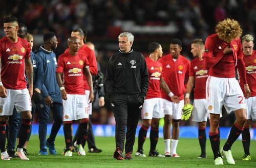 Jose Mourinho (centre) with the Manchester United team