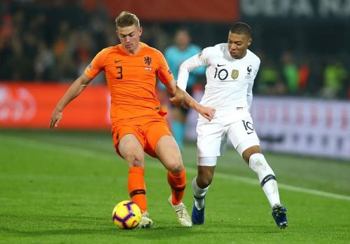 Mbappe trying to battle with Ajax's Matthjis de Ligt for possession during a frustrating evening