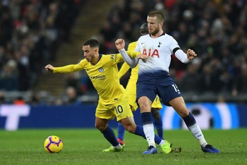 Hazard battling with Tottenham midfielder Eric Dier for possession during a frustrating evening at Wembley
