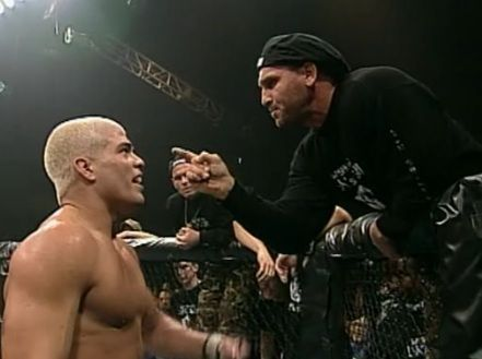 Ken Shamrock angrily confronts Tito Ortiz following the main event