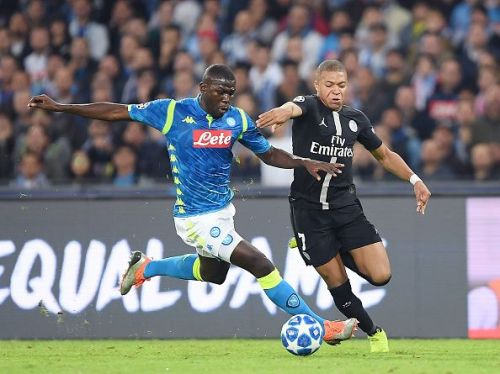Napoli's Kalidou Koulibaly in a duel with Kylian Mbappe during the UEFA Champions League Group C match at the Stadio Sao Paolo