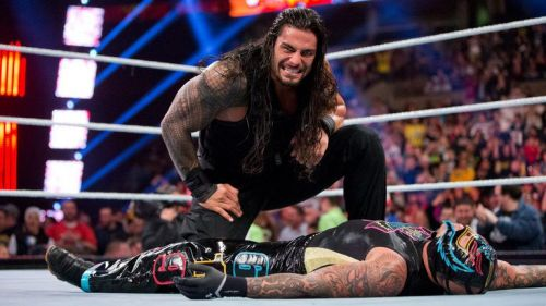 Roman Reigns eliminating Rey Mysterio