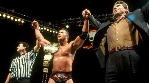 The Rock (with a little help) wins his first WWE Championship at Survivor Series 1998