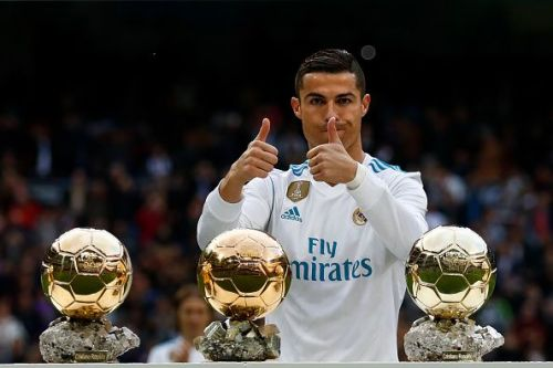 Ronaldo poses with his Ballon d'Or trophies