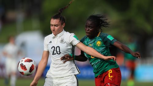 Number 20 Sophie Weidauer from Germany and Florence Fanta of Cameroon in action (Image Courtesy: FIFA)