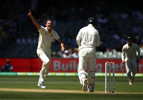 Josh Hazlewood celebrates after dismissing KL Rahul