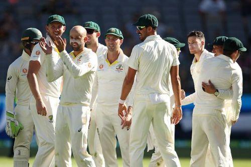 Australian team celebrate after the dismissal of Virat Kohli